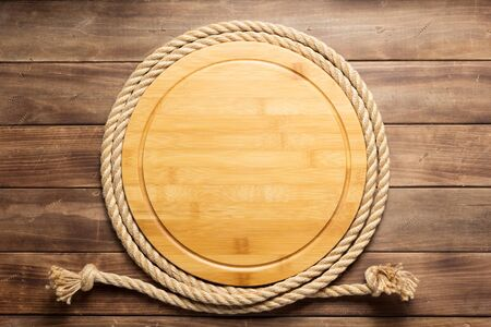 sign board and ship rope at wooden background texture