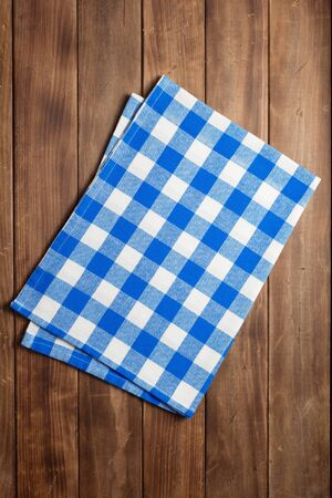 cloth napkin on at rustic wooden plank board table background, top view Stock Photo