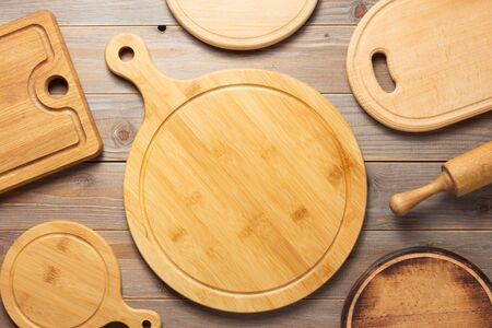 cutting board at wooden plank table board background, top view