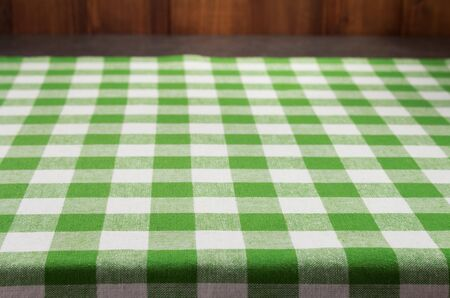 cloth napkin at rustic table in front, wooden plank board background Stockfoto