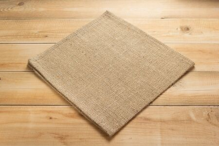 burlap hessian sacking cloth on wooden background table