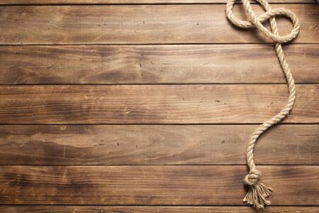 ship rope at wooden board background texture, top veiw