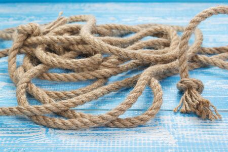 ship rope at wooden table, plank board background texture Stock Photo