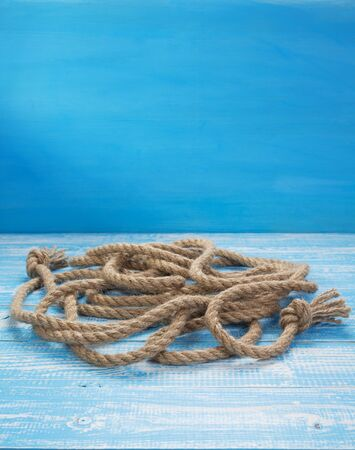 ship rope at wooden table, plank board background texture