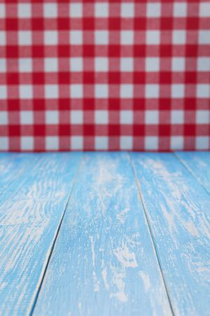 rustic wooden table in front and cloth napkin, plank board background Фото со стока