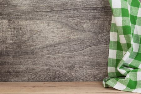 cloth napkin at rustic table in front, wooden plank board background Фото со стока