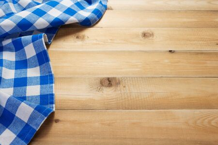 cloth napkin at rustic table in front,wooden plank board background