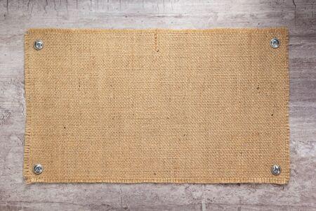 Burlap hessian sacking texture at stone wall surface
