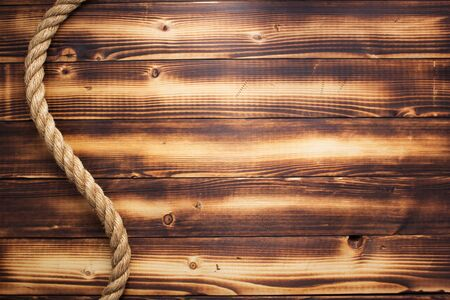 ship rope at wooden background, plank board texture