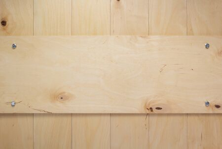 nameplate or wall sign at wooden board plywood background as texture surface Standard-Bild