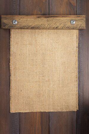 burlap hessian sacking texture on wooden background