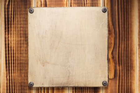 nameplate or wall sign on  wooden background