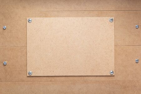 nameplate or wall sign at wooden mdf boards background as texture surface