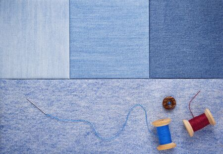 Sewing bobbin with thread on jeans
