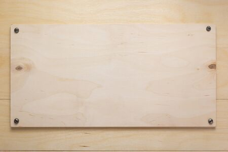 nameplate or wall sign at wooden board plywood background as texture surface 写真素材