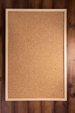 cork board on wooden background texture