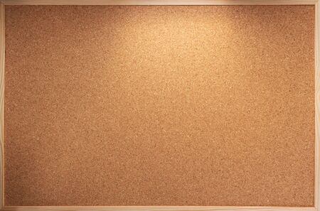 cork board in wooden frame as background texture Stock Photo