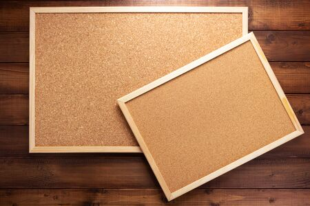 cork board on wooden background texture