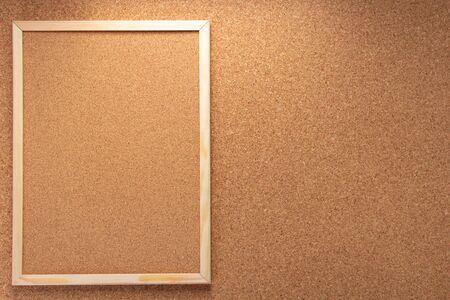 corkboard frame on cork background texture