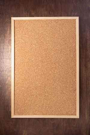 cork board on wooden background texture Stock Photo