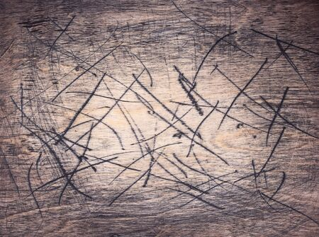 scratched wooden board background as texture surface