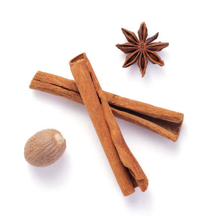 spices as cinnamon stick, anise star and nutmeg isolated on white background Stok Fotoğraf