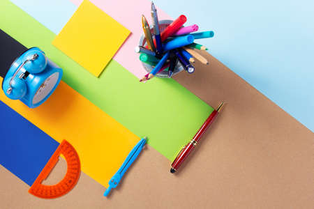 school accessories and office supplies at abstract paper background surface