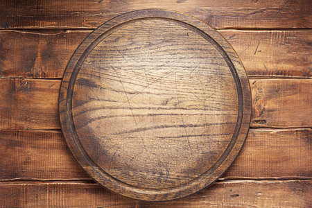 pizza cutting board or tray at wooden background texture