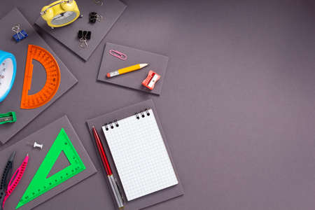 school accessories and office supplies at abstract gray paper background