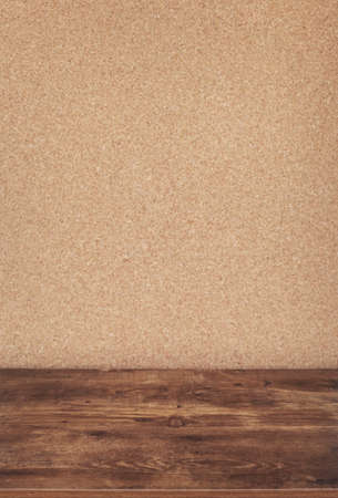 cork board wall background texture surface and wooden table or shelf