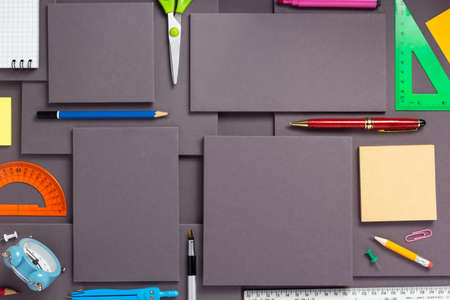 school or office accessories and supplies at a gray paper background texture