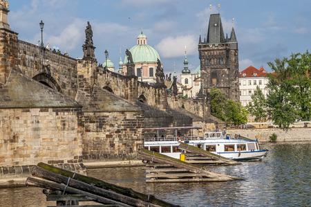 pleasure craft: Prague, Vltava River , Charles Bridge , view of the Mala Strana from the right bank . Pleasure boat on the river.