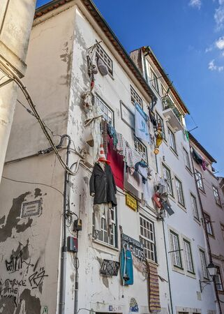 dorm: Portugal, Coimbra. Dorm students of one of the oldest universities in Europe in the medieval part of the city. The facade hung with old unwanted things.