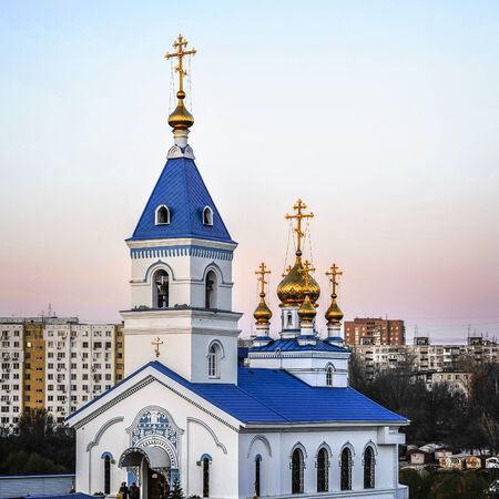 ondon: Rostov- on-Don. St. Iver convent. Church of the Iberian Icon of the Mother of God . The evening sun gilded walls of the temple . Happy Easter eve .