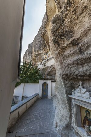 assumption: Entrance to the Church of the Assumption . Above the temple on the rock icon of the Mother of God .