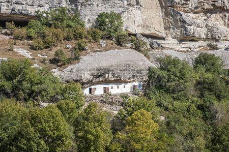 premises: Bakhchisaray , Crimea , Russia . Holy - Assumption Orthodox cave Monastery.Carved into the rock premises economic purposes .