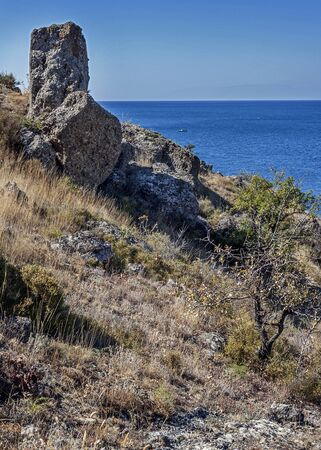 stark: The peninsula of Crimea , Russia. Neighborhoods city of Sudak . The stark beauty of the wild beaches of Cape Meganom .