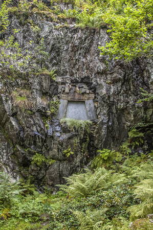 composers: Edvard  Grieg and his wife Nina are buried in a cliff-hewn tomb in the grounds looking out to the Lake Nordas.