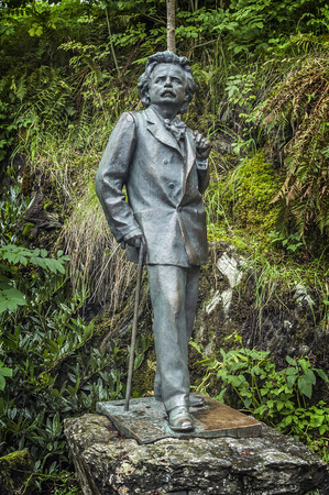 composer: Norway, Bergen. The estate - museum of Norwegian composer Edvard Grieg. The bronze sculpture of the famous Norwegian on one of the beautiful alleys of the park.