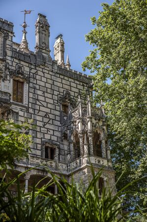 Portugal , Sintra . Palace Regaleira is typical Gothic architectural elements , such as turrets, gargoyles, and a tower in the shape of an octagon. Magnificent park .