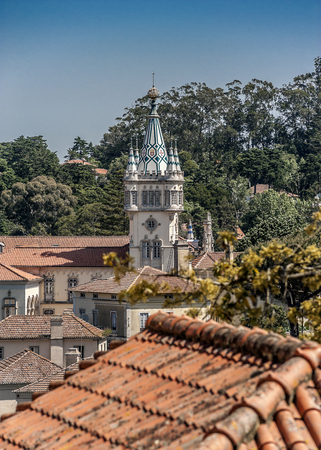 Portugal , Sintra . The ancient city of castles and palaces , stone houses whose roofs are made of tiles , narrow streets .