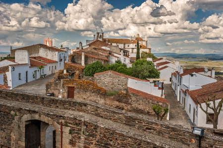 Monsaraz - a small border Portuguese fortress on top of a hill overlooking the vast expanses of the Alentejo vineyards, olive groves, and neighboring Spain Guadianu River, a natural border of Spain and Portugal