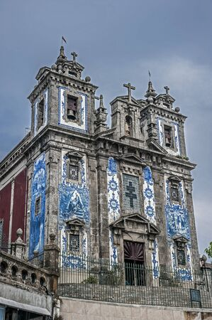 Portugal, Porto. Church of St. Ildefonso located near Batalha Square, was built in the Baroque style. Facade of the church, lined with famous azulejo tile panels.