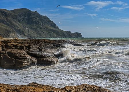 sudak: Russia, peninsula of Crimea, near Sudak. A small rough sea at Cape Frenchwoman.