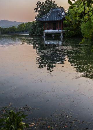 China, Hangzhou. Paradise in heaven and on earth - Hangzhou and Suzhou - Chinese proverb . Sunset at West Lake (Xihu)- Hangzhou main attractions . Stock Photo