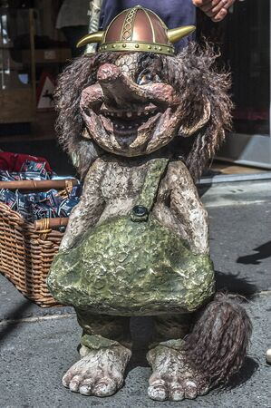 Oslo - the capital of Norway. Clear sunny summer day. Funny figurines of trolls the streets. Editorial