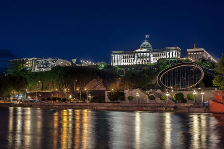 Georgia, Tbilisi night . View from the right bank of the Kura River in the complex of the Presidential Palace and the new concert hall .