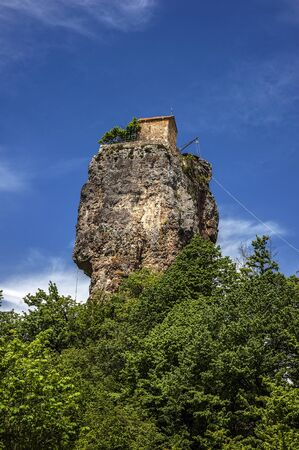 Georgia. Mans monastery near the village of Katskhi . The church and the abbot s cell on a rocky column of about fifty meters.