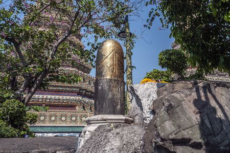 Thailand, Bangkok. Temple of the Reclining Buddha (Wat Pho). Black phallus (lingam) - men, touching it, ask for prosperity and good luck, and women - the possibility of the childs conception.