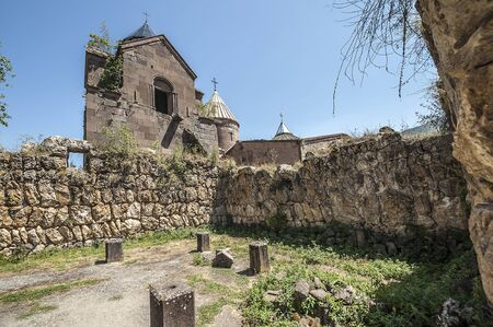 Armenia, the monastery complex Goshavank. Earthquake-damaged chapel-audience in the background of the bell tower of the Scriptorium.